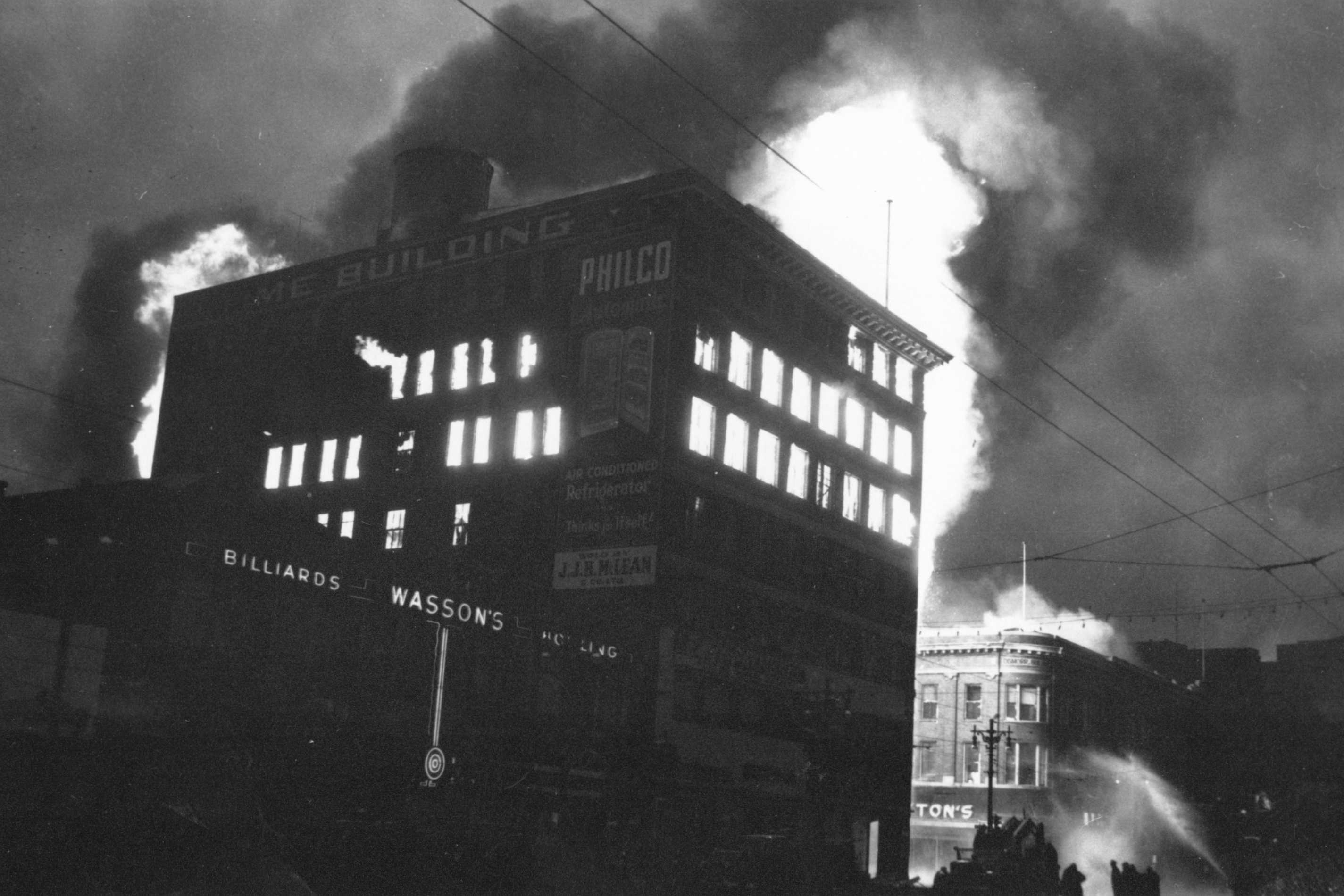 Time Building in early stages of fire (Eaton's can be seen in the background); June 8, 1954; Photographer: Jack Ablett, Source: Western Canadian Pictorial Index