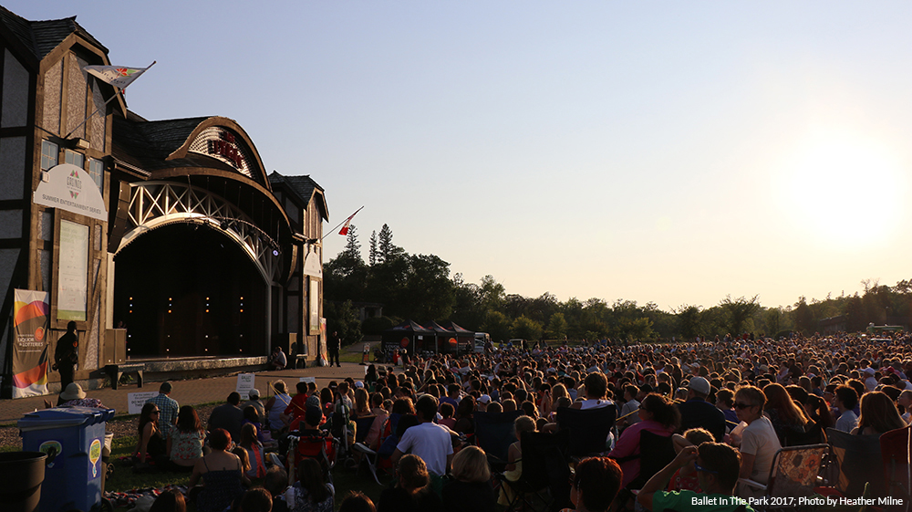 Photo of a croud sitting in front of Assiniboine Park's Lyric Theatre for Ballet In the Park
