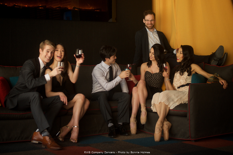 RWB company dancers relaxing on a couch in formal wear