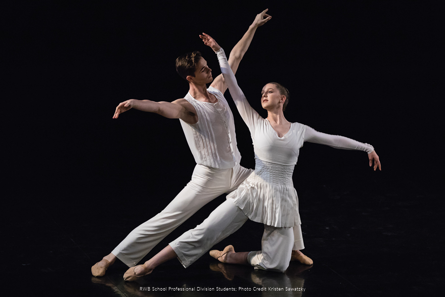 RWB School Professional Division Students wearing white costumes, in a dance pose.
