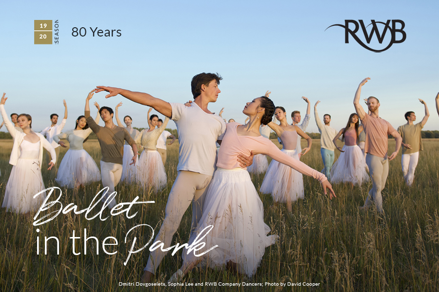 Photo of RWB Dancers Dmitri Dovgoselets and Sophia Lee in a dance pose, standing in a field in front of other RWB Dancers.