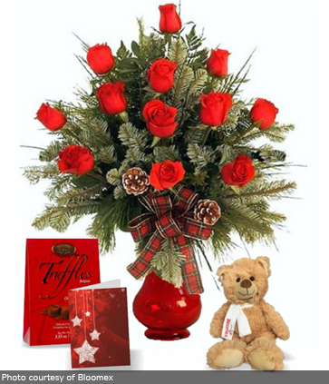 Image of a rose bouquet with chocolates and a stuffed bear